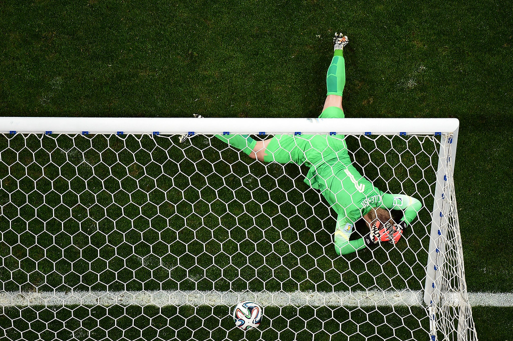 . Jasper Cillessen of the Netherlands reacts after being defeated by Argentina in a penalty shootout during the 2014 FIFA World Cup Brazil Semi Final match between the Netherlands and Argentina at Arena de Sao Paulo on July 9, 2014 in Sao Paulo, Brazil.  (Photo by Francois Xavier Marit - Pool/Getty Images)