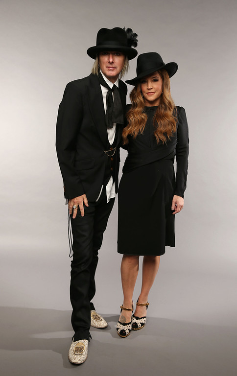 . NASHVILLE, TN - JUNE 05:  Musician Lisa Marie Presley (R) and Michael Lockwood pose at the Wonderwall portrait studio during the 2013 CMT Music Awards at Bridgestone Arena on June 5, 2013 in Nashville, Tennessee.  (Photo by Christopher Polk/Getty Images for Wonderwall)