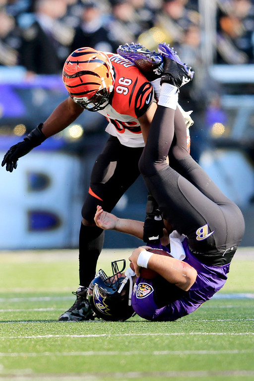 . Defensive end Carlos Dunlap #96 of the Cincinnati Bengals sacks quarterback Joe Flacco #5 of the Baltimore Ravens during the second quarter at M&T Bank Stadium on November 10, 2013 in Baltimore, Maryland.  (Photo by Rob Carr/Getty Images)