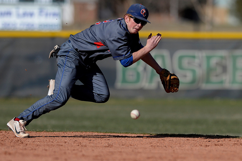 . Aurora, CO - APRIL 08: Ryan Robb (2) of the Cherry Creek Bruins dives for a ball that squeezes through the hole during the fourth inning of action. Overland hosted Cherry Creek on Tuesday, April 8, 2014. (Photo by AAron Ontiveroz/The Denver Post)