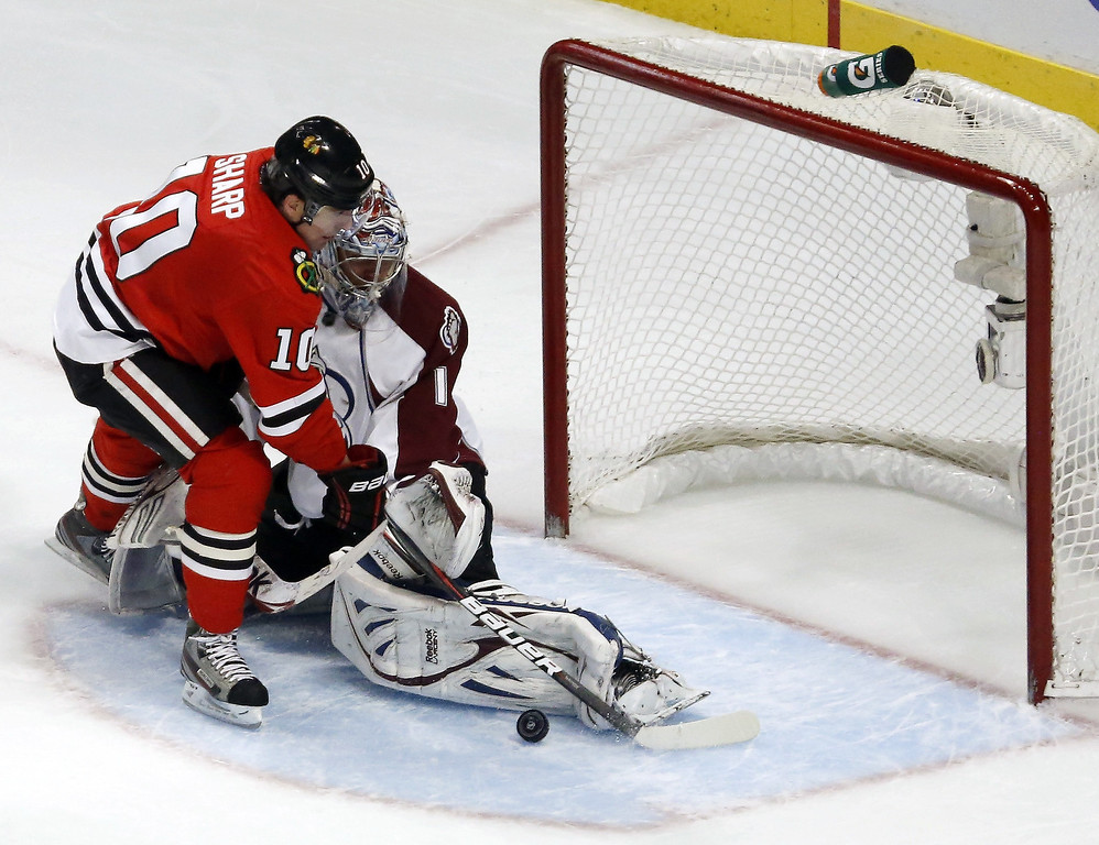 . Colorado Avalanche goalie Semyon Varlamov (1), of Russia, makes a save on a shot by Chicago Blackhawks center Patrick Sharp during the second period of an NHL hockey game, Wednesday, March 6, 2013, in Chicago. (AP Photo/Charles Rex Arbogast)