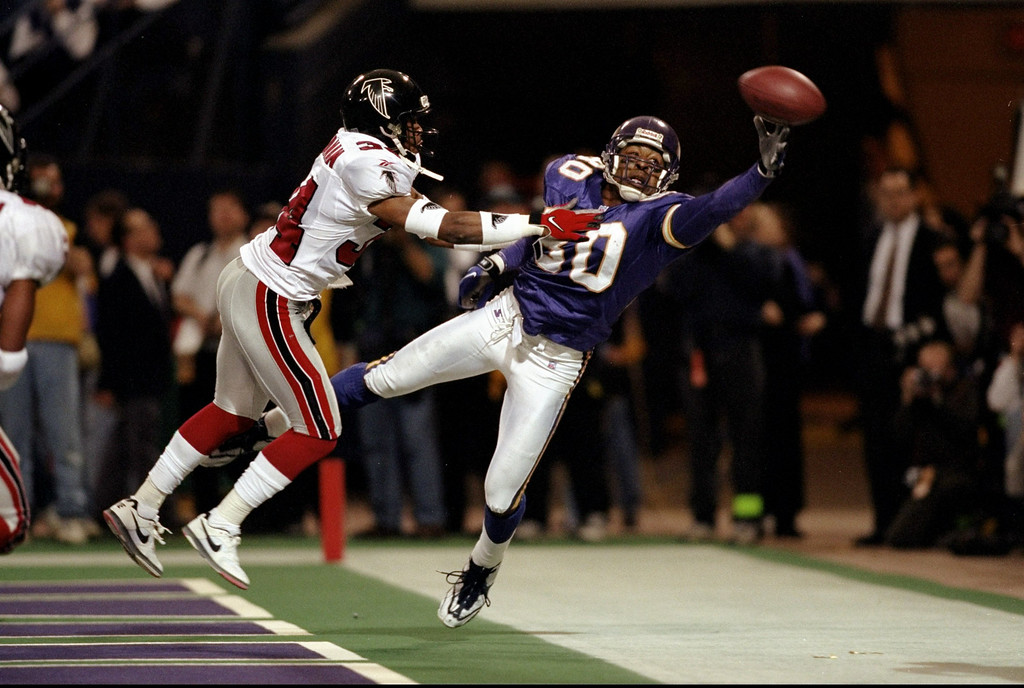 . 17 Jan 1999: Cris Carter #80 of the Minnesota Vikings tries for the catch during the NFC Championship Game against the Atlanta Falcons at the H. H. H. Metrodome in Minneapolis, Minnesota. The Falcons defeated the Vikings 30-27. Mandatory Credit: Andy Lyons  /Allsport