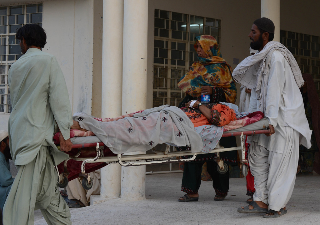 . Pakistani earthquake survivors carry an injured woman at a hospital in the devastated district of Awaran on September 28, 2013. A powerful 6.8-magnitude earthquake hit southwest Pakistan, killing at least 22 people in a region already devastated by a tremor which left more than 300 people dead this week, local officials said. BANARAS KHAN/AFP/Getty Images