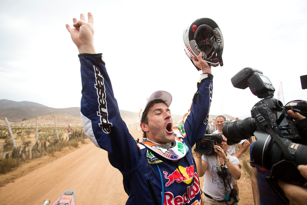 . KTM rider Marc Coma of Spain celebrates after winning the 2014 Dakar Rally at the end of the special of the thirteenth stage in Illapele, Chile, Saturday, Jan. 18, 2014. (AP Photo/Victor R. Caivano)