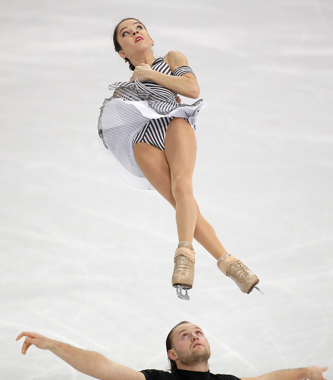 Description of . Vera Bazarova and Yuri Larionov of Russia compete in the pairs short program figure skating competition at the Iceberg Skating Palace during the 2014 Winter Olympics, Tuesday, Feb. 11, 2014, in Sochi, Russia. (AP Photo/Bernat Armangue)