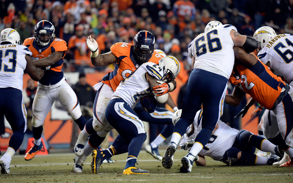 . Denver Broncos defensive tackle Terrance Knighton (94) takes down San Diego Chargers running back Ryan Mathews (24) during the first half.  The Denver Broncos vs. the San Diego Chargers at Sports Authority Field at Mile High in Denver on December 12, 2013. (Photo by Hyoung Chang/The Denver Post)