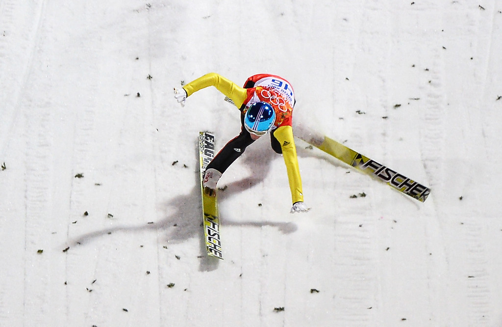 . Severin Freund of Germany crashes upon landing during the Men\'s Normal Hill Individual first round on day 2 of the Sochi 2014 Winter Olympics at the RusSki Gorki Ski Jumping Center on February 9, 2014 in Sochi, Russia.  (Photo by Lars Baron/Getty Images)