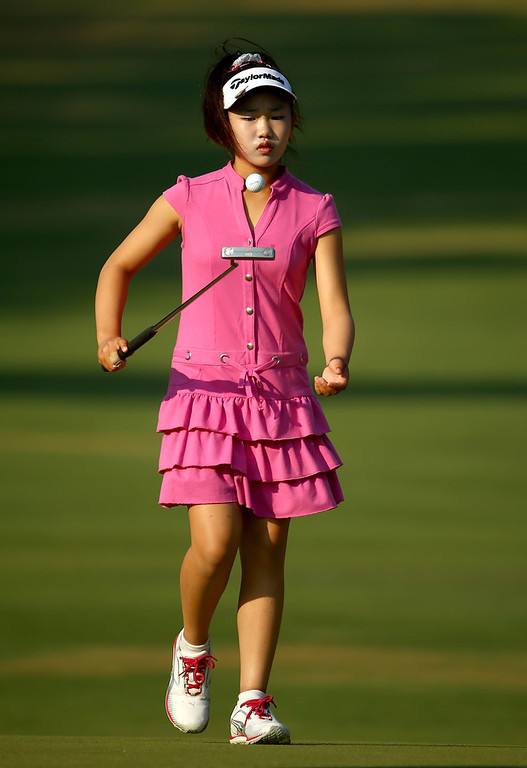 . Eleven-year old Amateur Lucy Li of the United States walks on the first green during a practice round prior to the start of the 69th U.S. Women\'s Open at Pinehurst Resort & Country Club, Course No. 2 on June 18, 2014 in Pinehurst, North Carolina.  (Photo by Streeter Lecka/Getty Images)