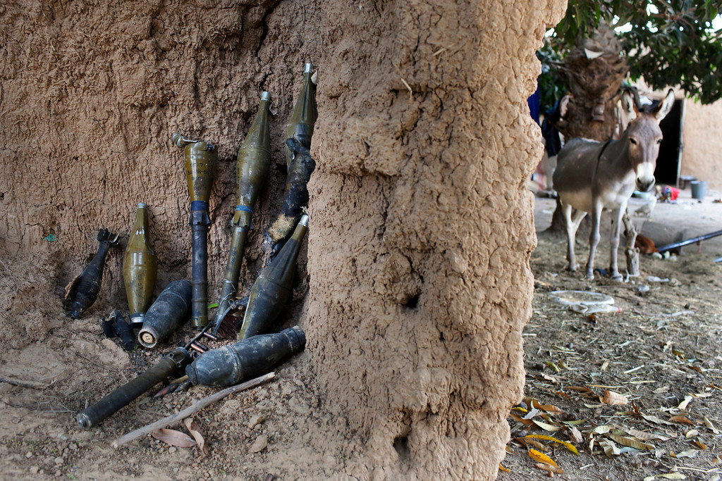 . Rocket-propelled grenades believed to belong to Islamist rebels are stockpiled next to a donkey in a courtyard in Diabaly January 23, 2013. REUTERS/Joe Penney
