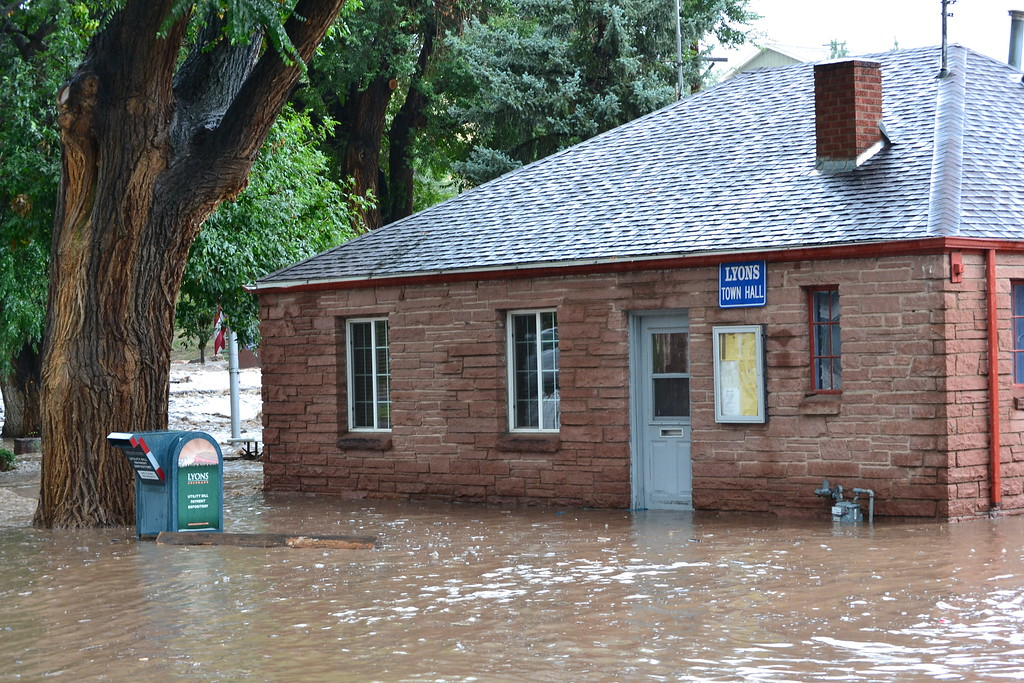 . Lyons Town Hall is flooding, in addition to our historic Library. Photo by Nina Embervine