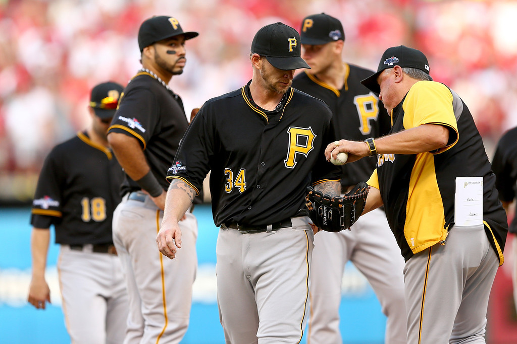 . ST LOUIS, MO - OCTOBER 03:  Starting pitcher A.J. Burnett #34 of the Pittsburgh Pirates is taken out of the game by manager Clint Hurdle #13 in the third inning against the St. Louis Cardinals during Game One of the National League Division Series at Busch Stadium on October 3, 2013 in St Louis, Missouri.  (Photo by Elsa/Getty Images)
