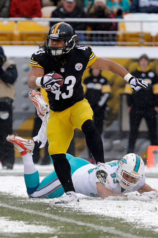 . Pittsburgh Steelers strong safety Troy Polamalu (43) gets past Miami Dolphins outside linebacker Jason Trusnik (93) as he returns a missed field goal attempt in the first half of an NFL football game in Pittsburgh, Sunday, Dec. 8, 2013. (AP Photo/Tom E. Puskar)