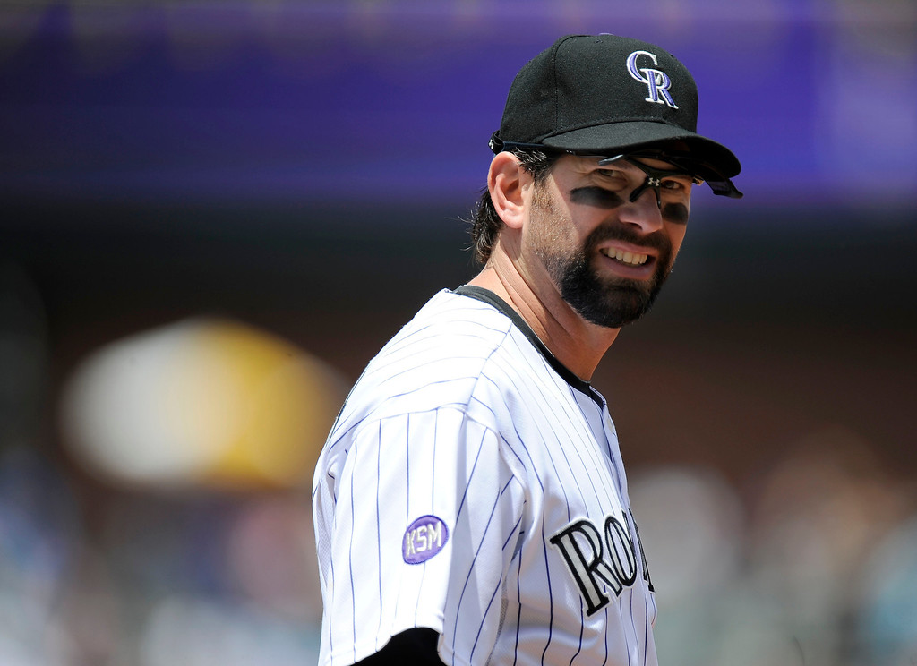 . Colorado Rockies Todd Helton (17) heads out to first base for the start of their game against the Houston Astros in June, 2010, at Coors Field. John Leyba, The Denver Post