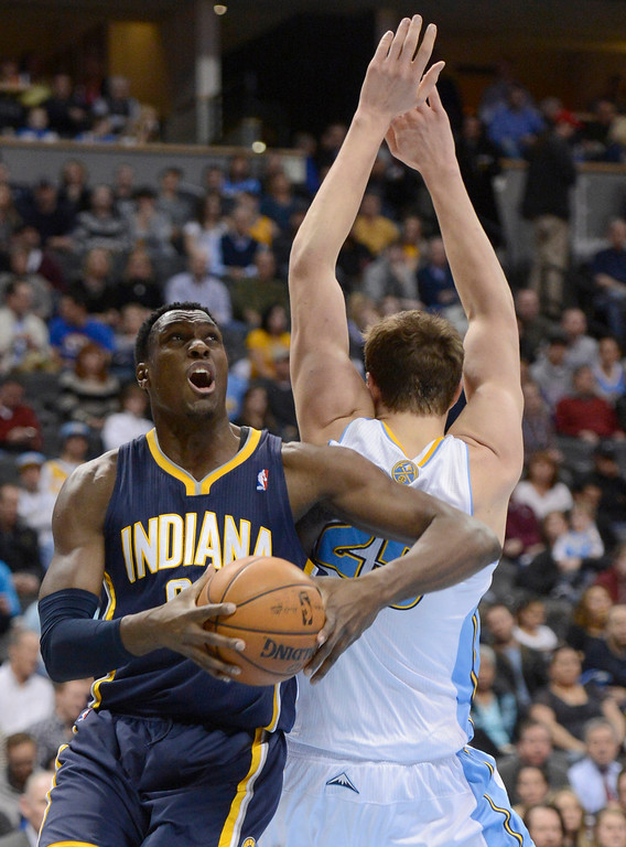 . DENVER, CO. - JANUARY 28: Indiana Pacers center Ian Mahinmi (28) drives past Denver Nuggets center Timofey Mozgov (25) during the second quarter January 28, 2013 at Pepsi Center. The Denver Nuggets host the Indiana Pacers in NBA action.  (Photo By John Leyba / The Denver Post)