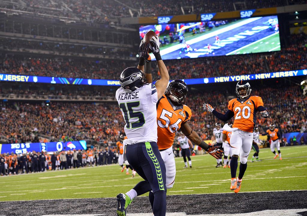 . Denver Broncos outside linebacker Nate Irving (56) denies Seattle Seahawks wide receiver Jermaine Kearse (15) in the end zone during the first quarter. The Denver Broncos vs the Seattle Seahawks in Super Bowl XLVIII at MetLife Stadium in East Rutherford, New Jersey Sunday, February 2, 2014. (Photo by Joe Amon/The Denver Post)