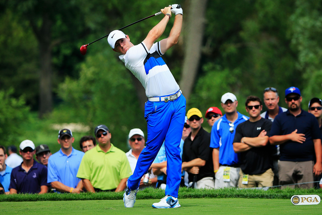 . ROCHESTER, NY - AUGUST 08:  Rory McIlroy of Northern Ireland hits his tee shot on the ninth hole during the first round of the 95th PGA Championship on August 8, 2013 in Rochester, New York.  (Photo by Sam Greenwood/Getty Images)