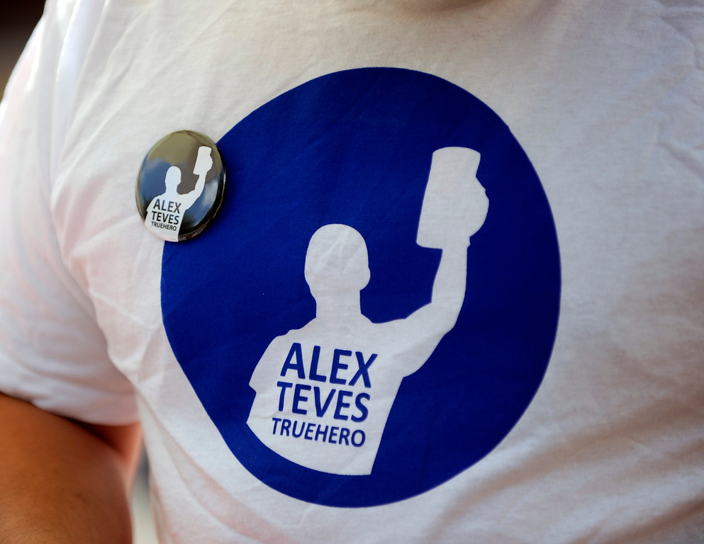 . AURORA, CO. - JULY 20: Friends and family of Alex Teves wore t-shirts in his honor at a fundraiser Saturday afternoon, July 20, 2013 at the Copper Kettle Brewing Company. Teves was a mug club member of the brewery. Ten other brewers and food trucks also contributed to the Night to Remember event.  Saturday marked the one-year anniversary of the Aurora theater shooting where Teves was one of a dozen people to lose their lives. Photo By Karl Gehring/The Denver Post