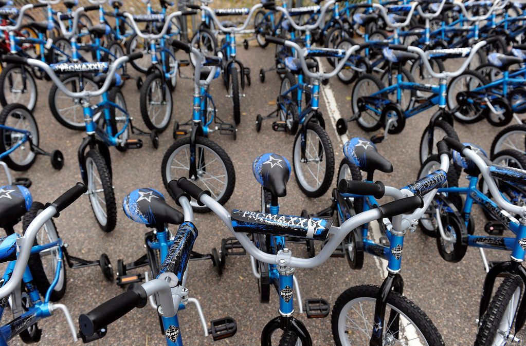 . DENVER, CO - Oct. 11: Hundreds of bikes wait for their young riders outside the Smith Renaissance School. Wish for Wheels and its volunteers build and give away over one hundred bikes to kindergarteners and first-graders at Smith Renaissance School in Park Hill. (Photo By Kathryn Scott Osler/The Denver Post)