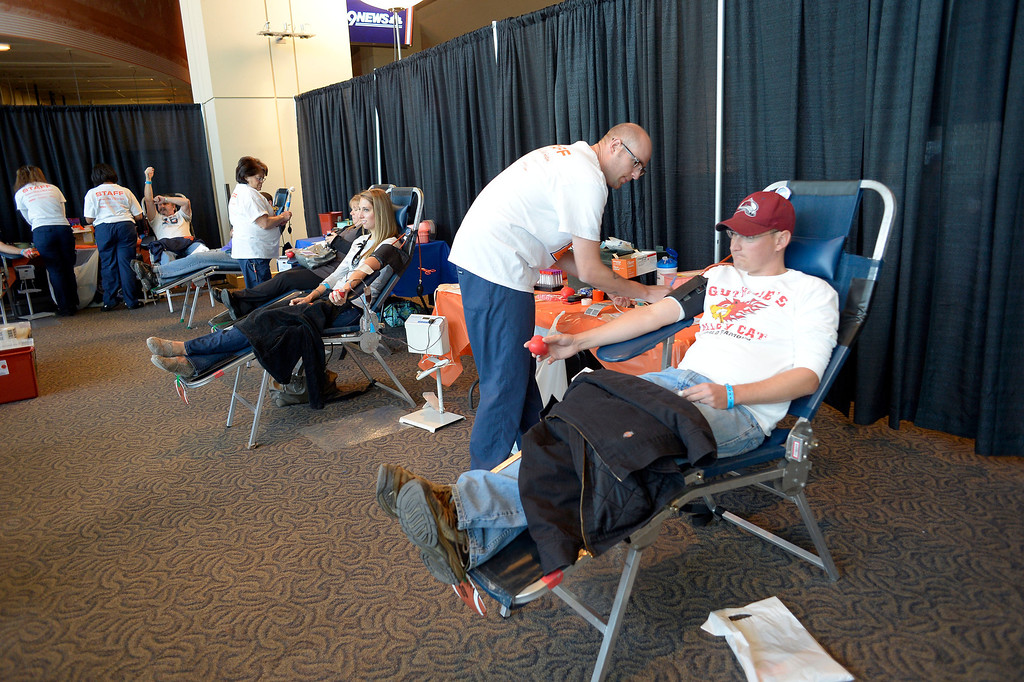 . DENVER, CO - OCTOBER 22: Blood donors sit in chairs to have their blood drawn during The Denver Broncos and Bonfils Blood Center\'s 16th annual Drive for Life community blood drive October 22, 2013 at Sports Authority Field. (Photo by John Leyba/The Denver Post)