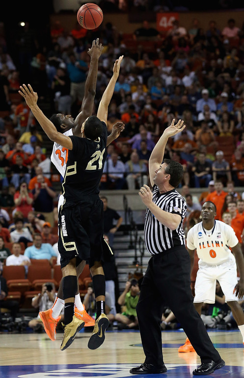 . AUSTIN, TX - MARCH 22:  Nnanna Egwu #32 of the Illinois Fighting Illini and Andre Roberson #21 of the Colorado Buffaloes tip off during the second round of the 2013 NCAA Men\'s Basketball Tournament at The Frank Erwin Center on March 22, 2013 in Austin, Texas.  (Photo by Stephen Dunn/Getty Images)