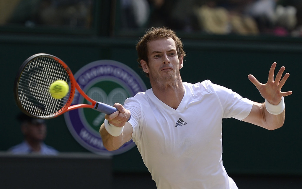 . Britain\'s Andy Murray returns against Serbia\'s Novak Djokovic during the men\'s singles final on day thirteen of the 2013 Wimbledon Championships tennis tournament at the All England Club in Wimbledon, southwest London, on July 7, 2013.  ADRIAN DENNIS/AFP/Getty Images