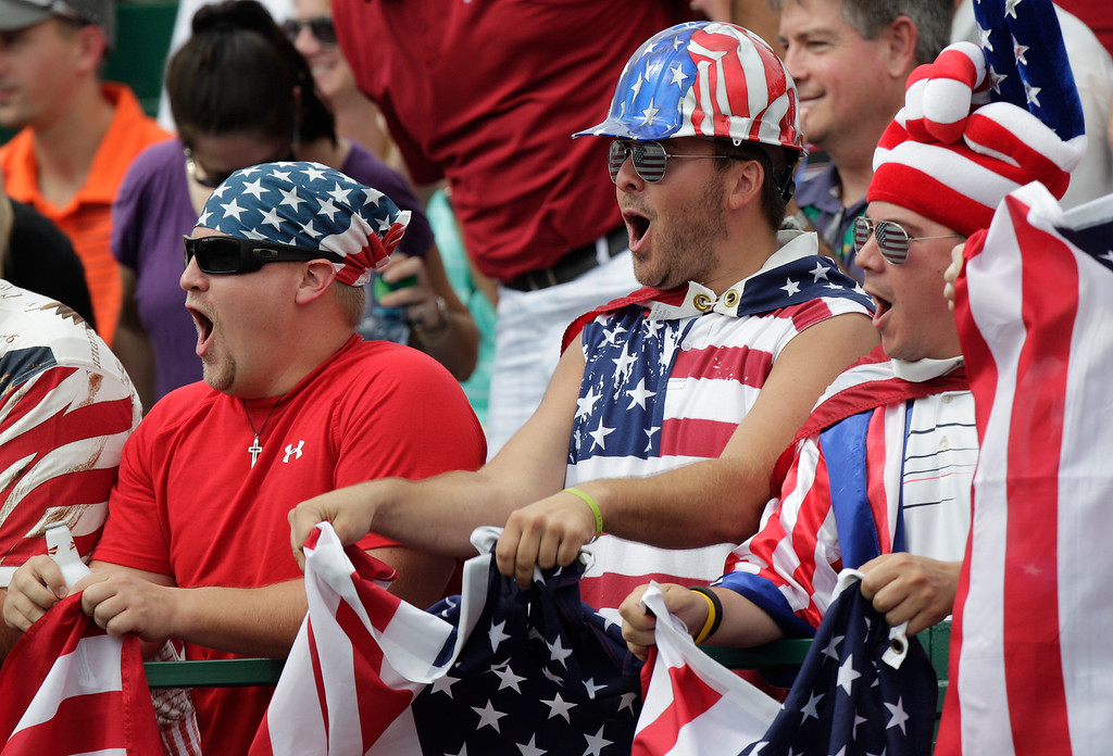 . United States fans cheer on the first hole during the foursome matches against the International team at the Presidents Cup golf tournament at Muirfield Village Golf Club Friday, Oct. 4, 2013, in Dublin, Ohio. (AP Photo/Jay LaPrete)