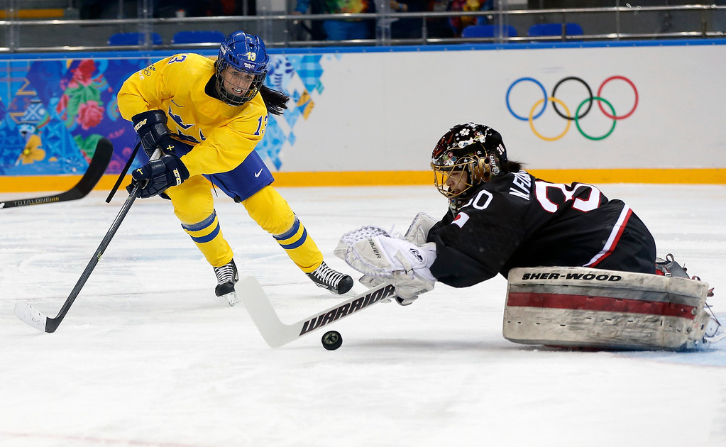 . Goalkeeper Nana Fujimoto of Japan blocks a shot on the goal by Lina Wester of Sweden during the 2014 Winter Olympics women\'s ice hockey game at Shayba Arena, Sunday, Feb. 9, 2014, in Sochi, Russia. (AP Photo/Petr David Josek)