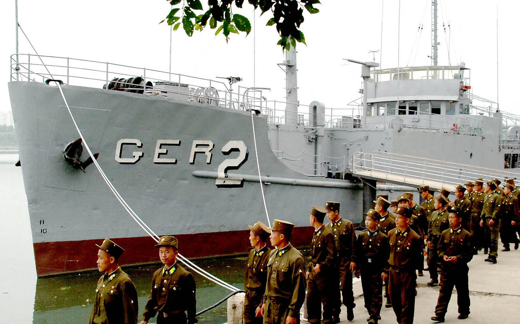 . FILE - In this Thursday, June 22, 2006 photo released by North Korea\'s Korea Central News Agency via Korea News Service, North Korean soldiers watch USS Pueblo, which was seized by North Korean navy off the Korean coast in Jan. 1968, near Taedonggang river in Pyongyang. The ship is North Koreaís greatest Cold War prize, a potent symbol of how the country has stood up to the great power of the United States, once in an all-out ground war and now with its push to develop the nuclear weapons and sophisticated missiles it needs to threaten the U.S. mainland. (AP Photo/Korea Central News Agency via Korea News Service)