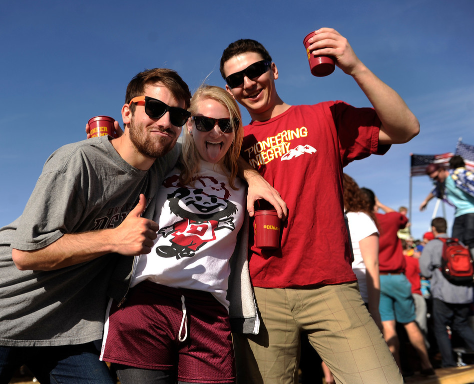 . DENVER, CO. - MARCH 2: University of Denver students Ben Crye, left, Rachel Watson, center, and Victor Woodson, right, partied outside Magness Arena before the game. The University of Denver men\'s basketball team defeated New Mexico State 66-60 Saturday evening, March 2, 2013. (Photo By Karl Gehring/The Denver Post)