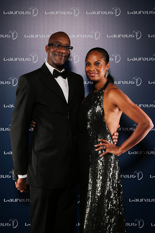 . Laureus Academy Chairman Edwin Moses and wife Michelle Moses pose in the winners studio during the 2013 Laureus World Sports Awards at Theatro Municipal do Rio de Janeiro on March 11, 2013 in Rio de Janeiro, Brazil.  (Photo by Ian Walton/Getty Images For Laureus)