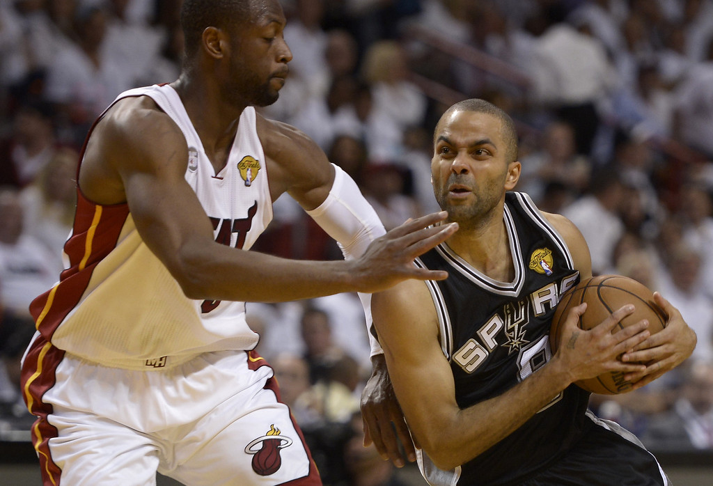 . Dwyane Wade (L) of the Miami Heat guards Tony Parker (R) of the San Antonio Spurs during the first half in Game 6 of the NBA Finals at the American Airlines Arena June 19, 2013 in Miami, Florida.  BRENDAN SMIALOWSKI/AFP/Getty Images