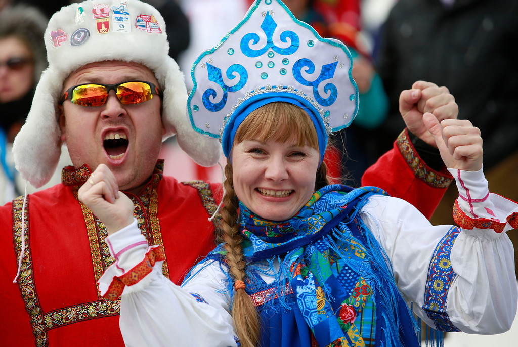 . Russian fans react before the start of women\'s super combined slalom at the Sochi 2014 Winter Olympics, Monday, Feb. 10, 2014, in Krasnaya Polyana, Russia. (AP Photo/Gero Breloer)