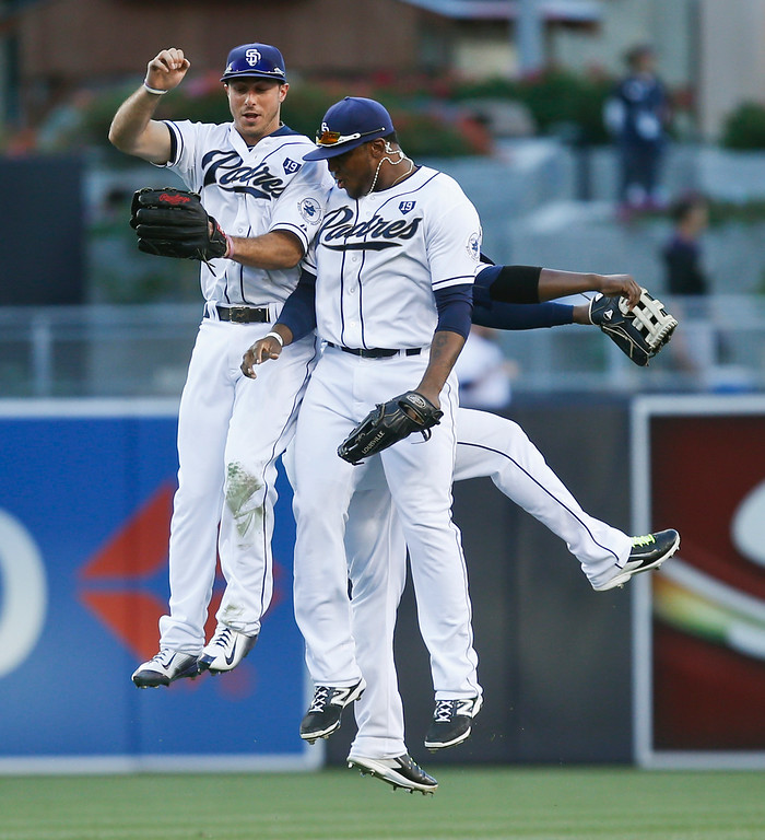 . San Diego Padres\' Tommy Medica, left, Rymer Liriano, and Abraham Almonte, rear, celebrate after the Padres\' 5-3 victory over the Colorado Rockies in a baseball game Wednesday, Aug. 13, 2014, in San Diego. The Padres swept the three game series and have won 9 of their last 11 games. (AP Photo/Lenny Ignelzi)