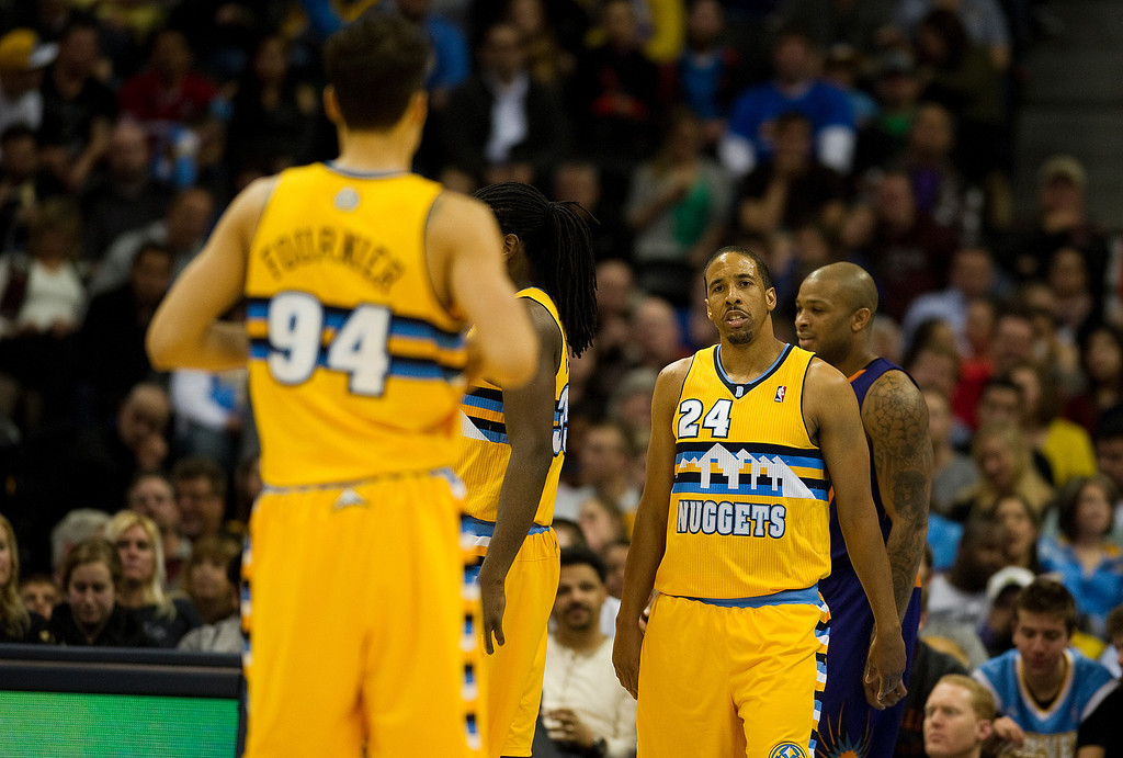 . DENVER, CO - DECEMBER 20: Andre Miller #24 of the Denver Nuggets look toward Evan Fournier #94 of the Denver Nuggets during a break in play during a game against the Phoenix Suns at the Pepsi Center on December 20, 2013, in Denver, Colorado. The Suns won 103-99. (Photo by Daniel Petty/The Denver Post)