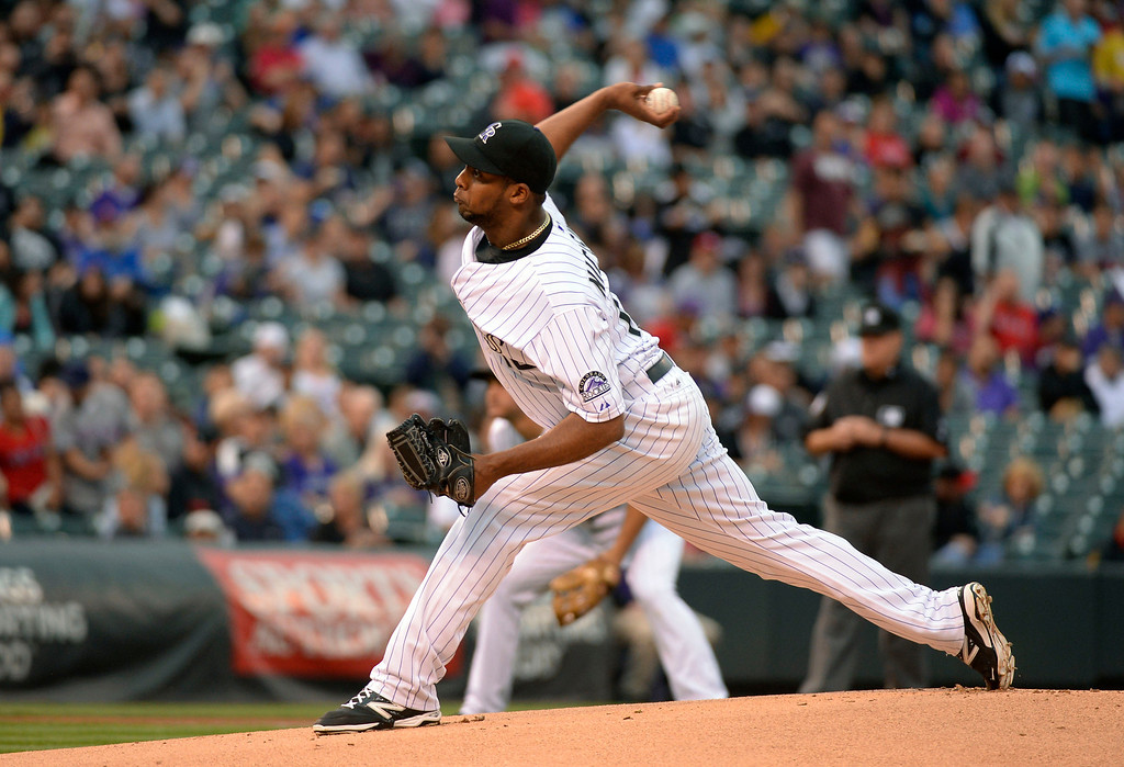 . DENVER, CO - MAY 06: Colorado Rockies starting pitcher Juan Nicasio (12) delivers a pitch in the first inning against the Texas Rangers May 6, 2014 at Coors Field. (Photo by John Leyba/The Denver Post)