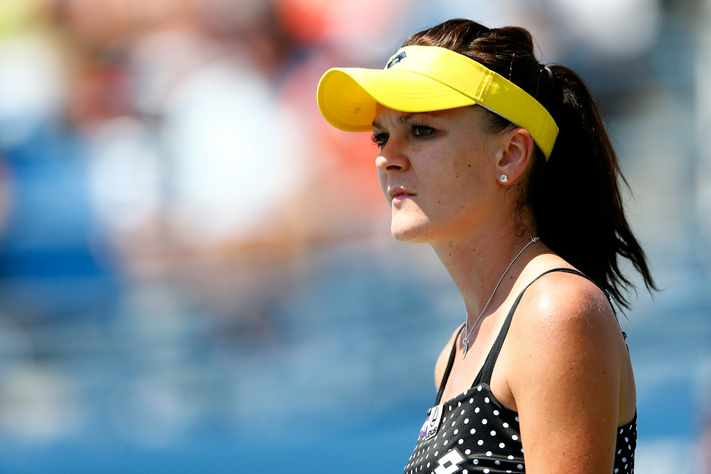 . NEW YORK, NY - AUGUST 27:  Agnieszka Radwanska of Poland looks on against Shuai Peng of China on Day Three of the 2014 US Open at the USTA Billie Jean King National Tennis Center on August 27, 2014  in the Flushing neighborhood of the Queens borough of New York City.  (Photo by Julian Finney/Getty Images)