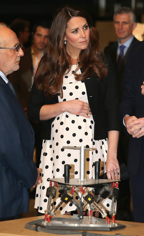 """. Britain\'s Kate the Duchess of Cambridge with her husband Prince William and his brother Prince Harry, not pictured, attend the inauguration of \""""Warner Bros. Studios Leavesden\"""" near Watford, approximately 18 miles north west of central London, Friday, April 26, 2013. As well as attending the inauguration Friday at the former World War II airfield site, the royals will undertake a tour of Warner Bros. \""""Studio Tour London - The Making of Harry Potter\"""", where they will view props, costumes and models from the Harry Potter film series. (AP Photo/Chris Jackson, Pool)"""
