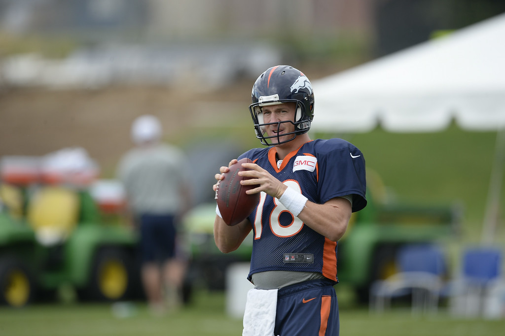 . Denver Broncos quarterback Peyton Manning (18) warms up before the start of day 12 of the Denver Broncos 2014 training camp August 5, 2014 at Dove Valley. (Photo by John Leyba/The Denver Post)