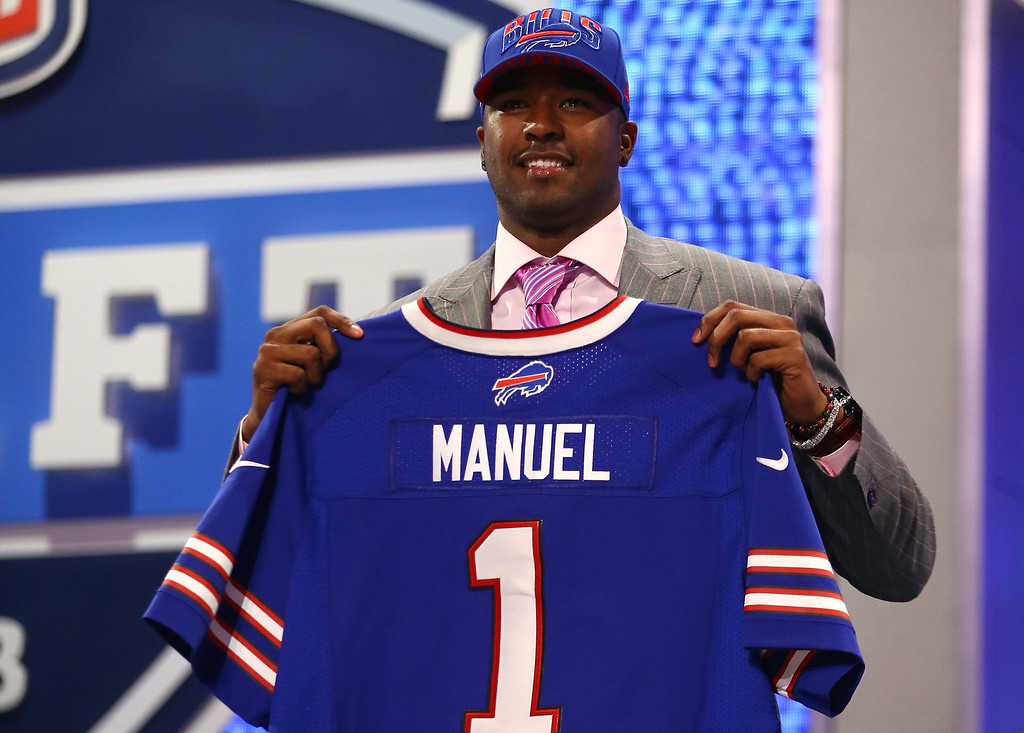 . E.J. Manuel of the Florida State Seminoles holds up a jersey on stage after he was picked #16 overall by the Buffalo Bills in the first round of the 2013 NFL Draft at Radio City Music Hall on April 25, 2013 in New York City.  (Photo by Al Bello/Getty Images)