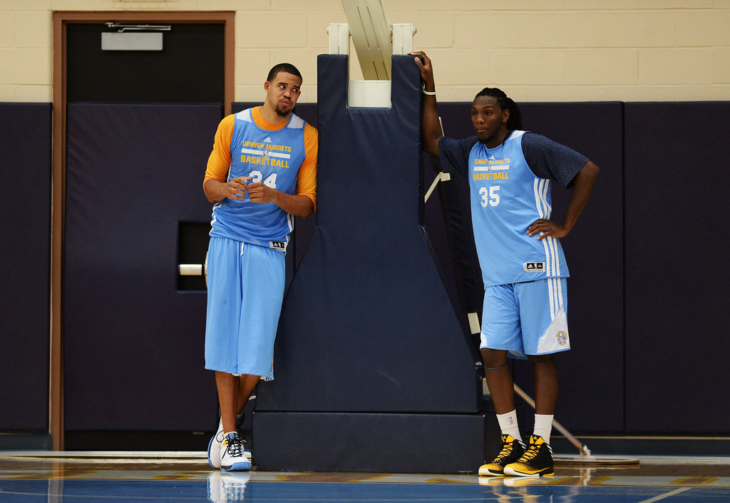 . JaVale McGee of Denver Nuggets (34), left, and Kenneth Faried (35) are having a break during the team practice at Pepsi Center. Denver, Colorado. October 2, 2013. (Photo by Hyoung Chang/The Denver Post)