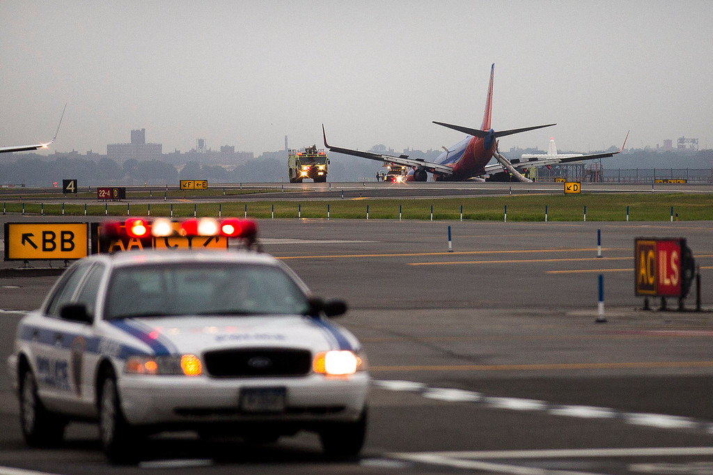 . A southwest airlines plane rests on the tarmac after what officials say was a nose gear collapse during a landing at LaGuardia Airport, Monday, July 22, 2013, in New York. The Federal Aviation Administration says the plane landed safely.  (AP Photo/John Minchillo)