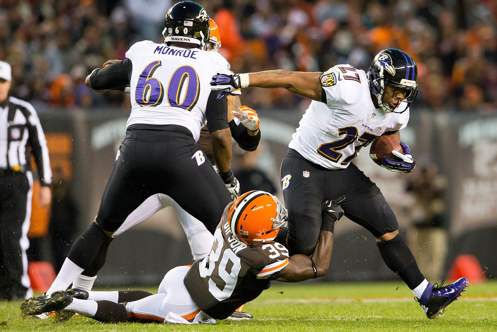 . Free safety Tashaun Gipson #39 of the Cleveland Browns tackles running back Ray Rice #27 of the Baltimore Ravens during the first half at FirstEnergy Stadium on November 3, 2013 in Cleveland, Ohio. (Photo by Jason Miller/Getty Images)