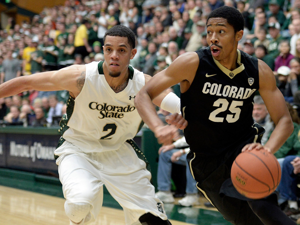. Colorado\'s Spencer Dinwiddie drives to the hoop past Daniel Bejarano during an NCAA game against CSU on Tuesday, Dec. 3, 2013, at the Moby Arena in Fort Collins. CU won the game 67-62.