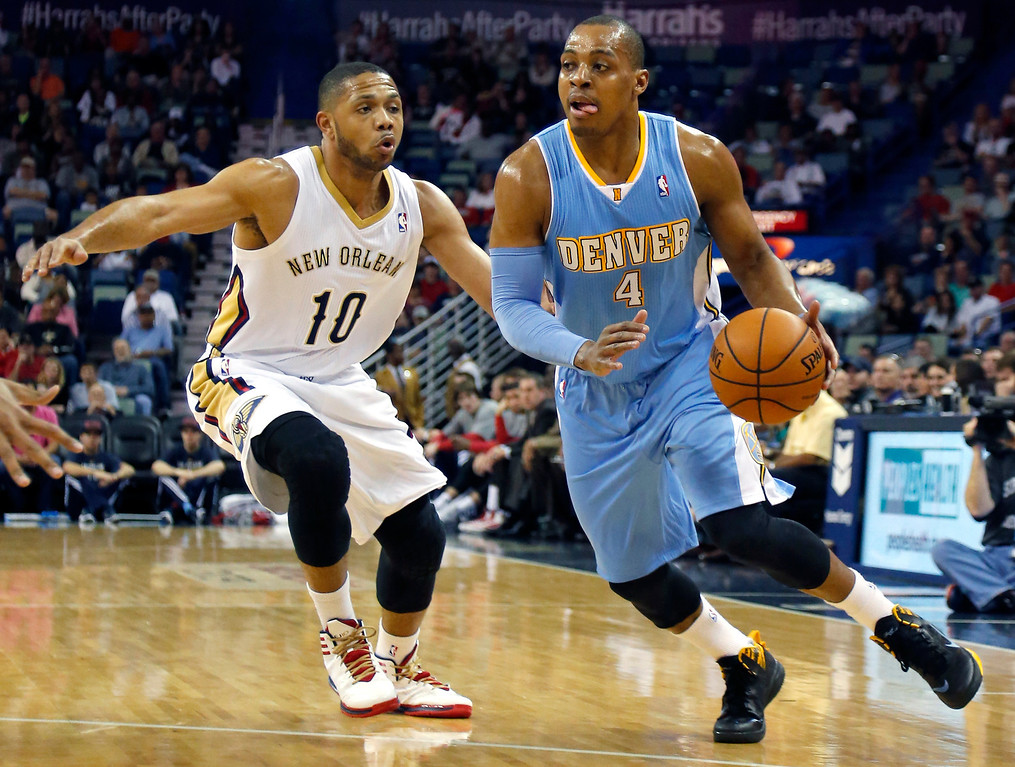 . Denver Nuggets shooting guard Randy Foye (4) drives past New Orleans Pelicans shooting guard Eric Gordon (10) in the first half of an NBA basketball game in New Orleans, Sunday, March 9, 2014. (AP Photo/Bill Haber)