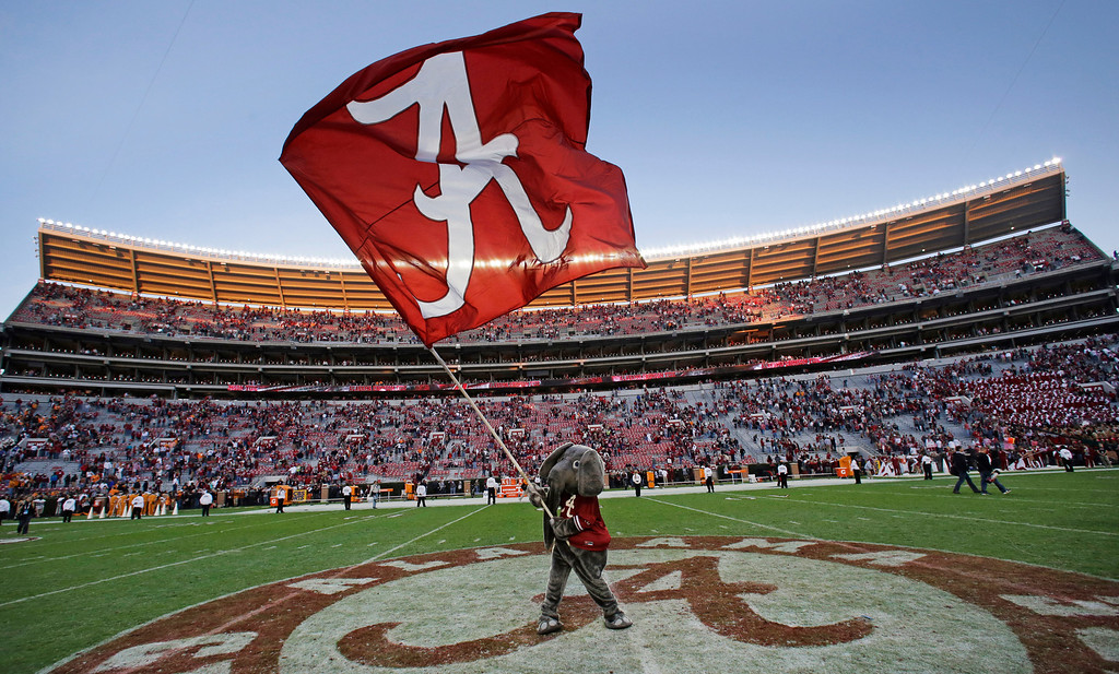 . Alabama mascot Big Al waves an Alabama flag following a 45-10 win over Tennessee in an NCAA college football game in Tuscaloosa, Ala., Saturday, Oct. 26, 2013. (AP Photo/Dave Martin)