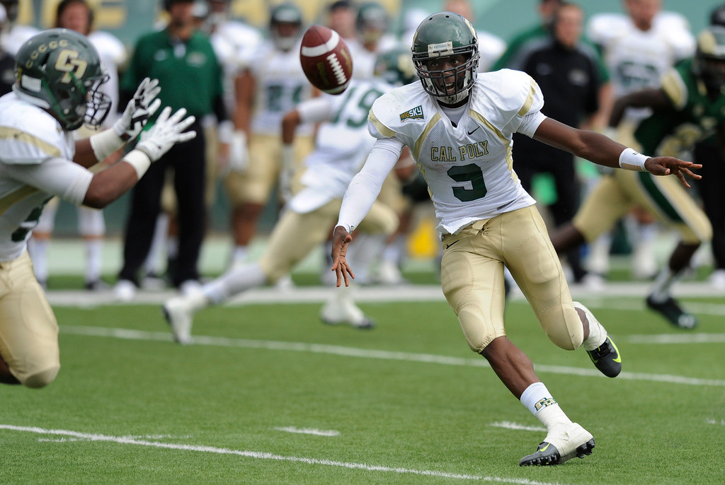 . FORT COLLINS, CO. - SEPTEMBER 14: Mustangs\' quarterback Chris Brown (9) pitched the ball to split back Kristaan Ivory (5) in the third quarter. The Colorado State University football team defeated Cal Poly at Hughes Stadium in Fort Collins Saturday afternoon, September 14, 2013.  It was the Rams\' first home game and first win of the season. Photo By Karl Gehring/The Denver Post
