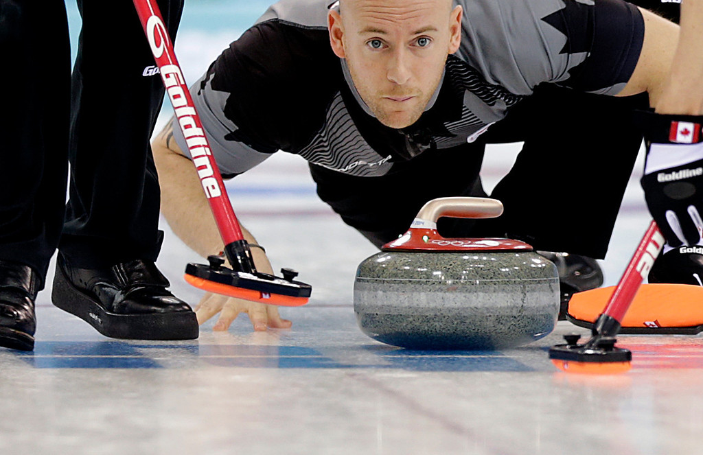 . Canada\'s Ryan Fry releases the rock during the men\'s curling competition against Britain at the 2014 Winter Olympics, Saturday, Feb. 15, 2014, in Sochi, Russia. (AP Photo/Wong Maye-E)