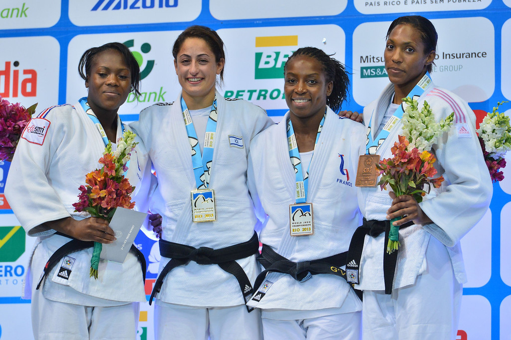 . Israel\'s gold medallist Yarden Gerbi (2-L), France\'s silver medallist Clarisse Agbegnenou (L), and bronze medallists Anicka Van Emden (R) from the Netherlands and French Gevrise Emane pose on the podium during the medal ceremony for the women\'s -63kg category, during the IJF World Judo Championship, in Rio de Janeiro, Brazil, on August 29, 2013. YASUYOSHI CHIBA/AFP/Getty Images