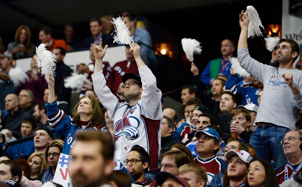 . Avalanche fans cheer on their team during the third period.  (Photo by John Leyba/The Denver Post)
