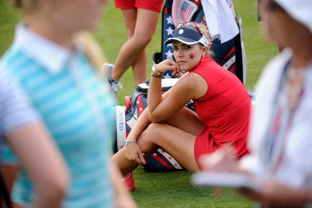 . PARKER, CO. - AUGUST 17: American golfer Lexi Thompson, center, watched as her English competitor Charley Hull, left, was interviewed on the 18th green Saturday at the Solheim Cup. The European combination of Jodi Ewart-Shadoff and Hull defeated Paula Creamer and Thompson Saturday afternoon. It was the American Team versus the Europeans as play continued at the Colorado Golf Club Saturday afternoon, August 17, 2013. Photo By Karl Gehring/The Denver Post